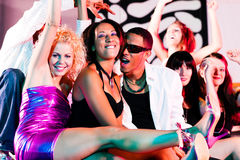 Group of friends in nightclub Royalty Free Stock Photos