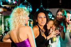Group of friends in nightclub Stock Images