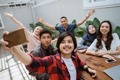 Group of friends office enjoy gathering with selfie royalty free stock photo