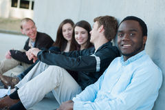 Group of Friends Outside on Campus. Group of diver friends outside smiling on campus Royalty Free Stock Images