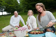 Group of Friends in Park with BBQ Stock Image