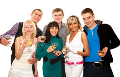 Group of friends at a party. Three young couples with glasses of champagne at a party or celebration Royalty Free Stock Photos