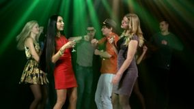 Group of friends at party dancing. Two girls the stock footage
