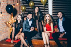 Group of friends on party event. New year, Birthday, Holiday Event concept Royalty Free Stock Photography
