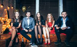 Group of friends on party event. New year, Birthday, Holiday Event concept royalty free stock photo