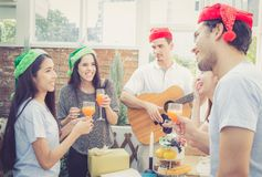 Group of friends party and playing guitar, Surprise birthday, celebrate party christmas and new year. Holiday and vacation concept Royalty Free Stock Photography