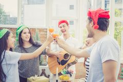 Group of friends party and playing guitar, Surprise birthday, celebrate party christmas and new year. Holiday and vacation concept Stock Images