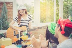 Group of friends party and playing guitar, Surprise birthday. Celebrate party christmas and new year, holiday and vacation concept Stock Images