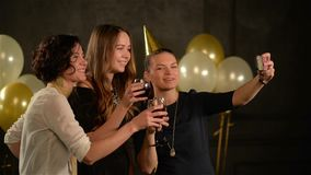 Group of Friends at a Party Taking Selfies with Glasses in Hands. Smiling Women Have Fun During Celebration of Birthday stock video