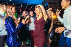 Friends partying in a nightclub. Group of friends partying in a nightclub royalty free stock photo