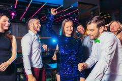 Friends partying in a nightclub. Group of friends partying in a nightclub royalty free stock photos
