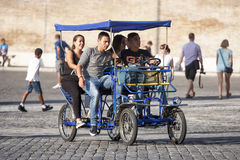 Group friends on pedal rickshaw (risciò) Royalty Free Stock Photography