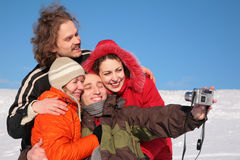 Group of friends photographs itself. In winter stock photography