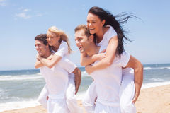 Group friends piggyback Stock Image