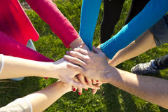 Group of friends pile up hands as unity oath Royalty Free Stock Image