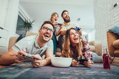Group of friends play video games. Together Stock Photo