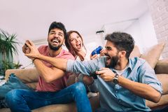 Group of friends play video games. Together Royalty Free Stock Photography