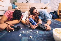 Group of friends play video games. Together Royalty Free Stock Photos