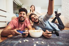 Group of friends play video games. Together Stock Photos