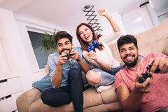 Group of friends play video games. Together Royalty Free Stock Image