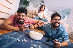 Group of friends play video games. Together Royalty Free Stock Photo
