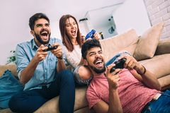 Group of friends play video games. Together Stock Image