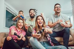Group of friends play video games together. Group of friends play video games together having fun Stock Images