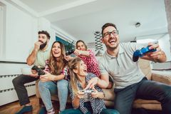 Group of friends play video games together. Group of friends play video games together having fun Royalty Free Stock Photos