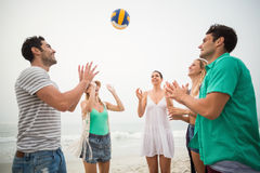 Group of friends playing with a beach ball. On the beach Stock Photo