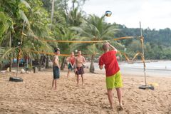 Group of friends playing beach volley - Multi-ethic group of peo royalty free stock photography