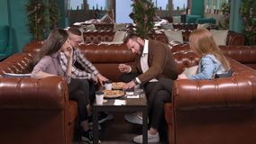 Group of friends playing board games in a cafe. Group of friends playing board games in a cafe stock video