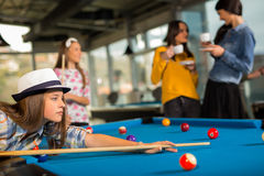 Group of friends playing pool together. Royalty Free Stock Photos