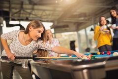 Group of friends playing pool together. Stock Images
