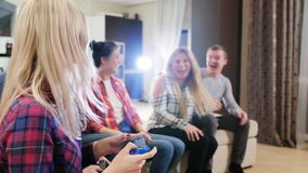 Group of friends playing Video Games. Group of friends sitting on the couch and gaming stock footage