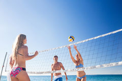 Group of friends playing volleyball Stock Photo