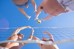 Group of friends playing volleyball Royalty Free Stock Photo