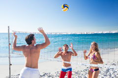 Group of friends playing volleyball Stock Image