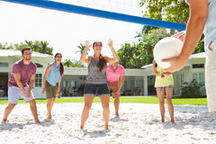 Group Of Friends Playing Volleyball In Garden Royalty Free Stock Photography