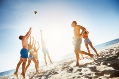 Group friends plays ball beach sea Stock Images