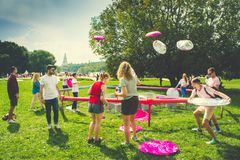 A group of friends plays Inflatable frisbee in park Kolomenskoe, Moscow stock photo