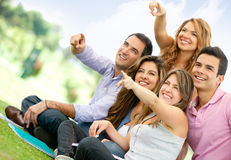 Group of friends pointing Stock Photos