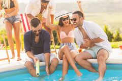 Summertime poolside party stock photo