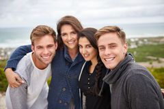 Group of friends posing for a picture together outdoors Royalty Free Stock Photography