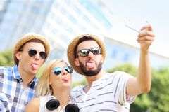 Group of friends posing to picture Stock Photo