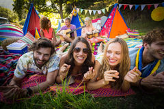 Group of friends posing together at campsite. Portrait of group of friends posing together at campsite on a sunny day royalty free stock photo