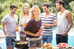 Group of friends preparing for outdoors barbecue party Royalty Free Stock Photo
