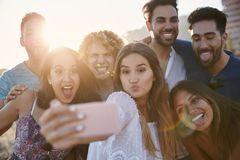 Group of friends pulling faces to selfie together. Portrait of group of friends pulling faces to selfie together Stock Image