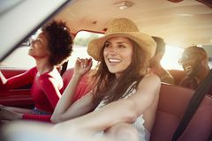 Group Of Friends Relaxing In Car During Road Trip Royalty Free Stock Image
