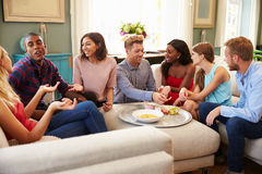 Group Of Friends Relaxing At Home On Sofa Together Stock Photos