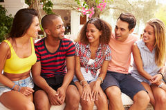 Group Of Friends Relaxing Outdoors On Holiday Together Royalty Free Stock Photo